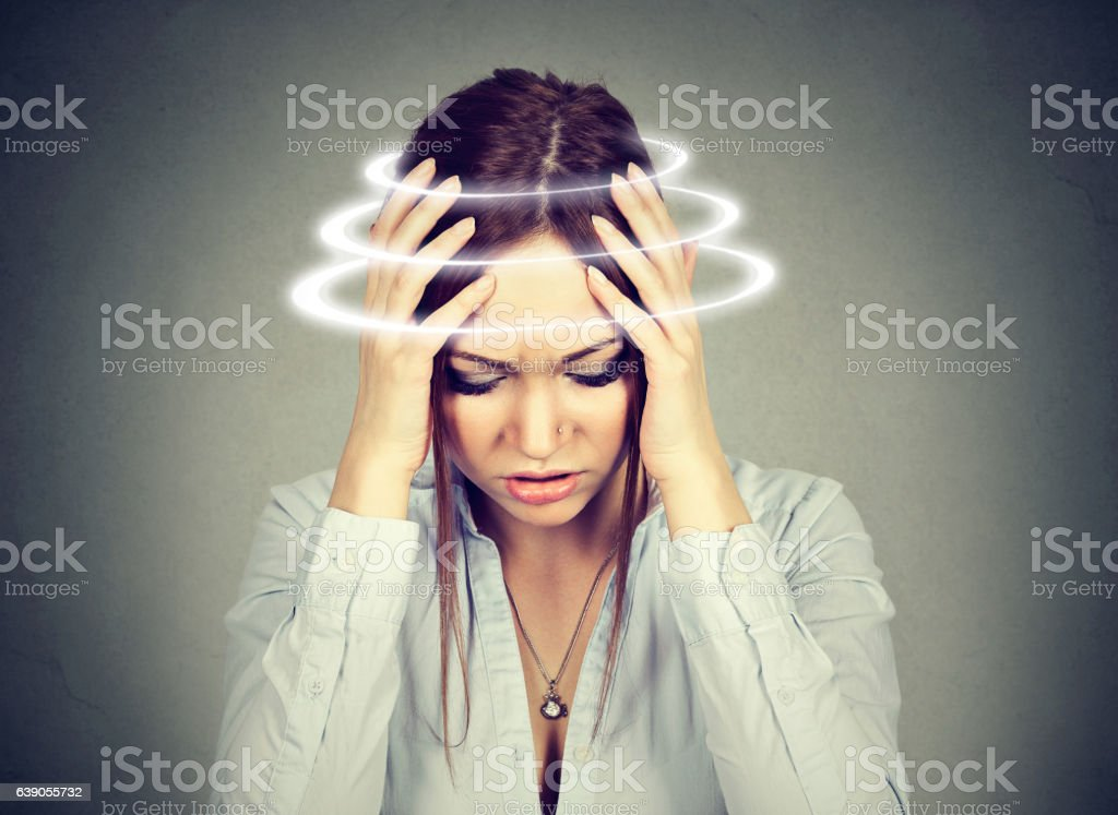 Woman with vertigo. Young female suffering from dizziness stock photo
