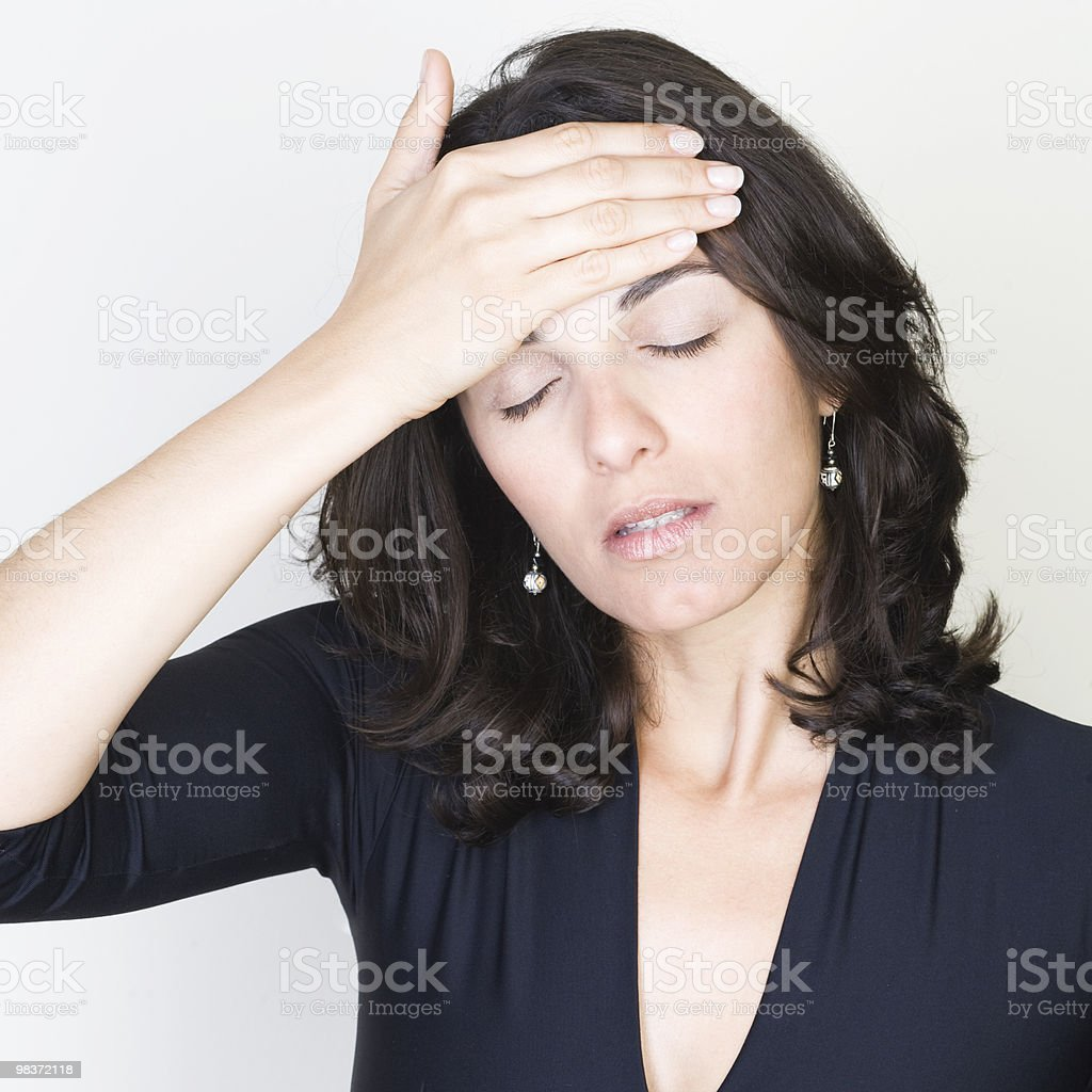 Woman with vicious headache caused by stress royalty-free stock photo
