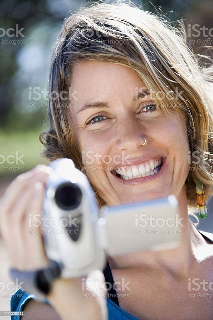 Woman with video camera. royalty-free stock photo