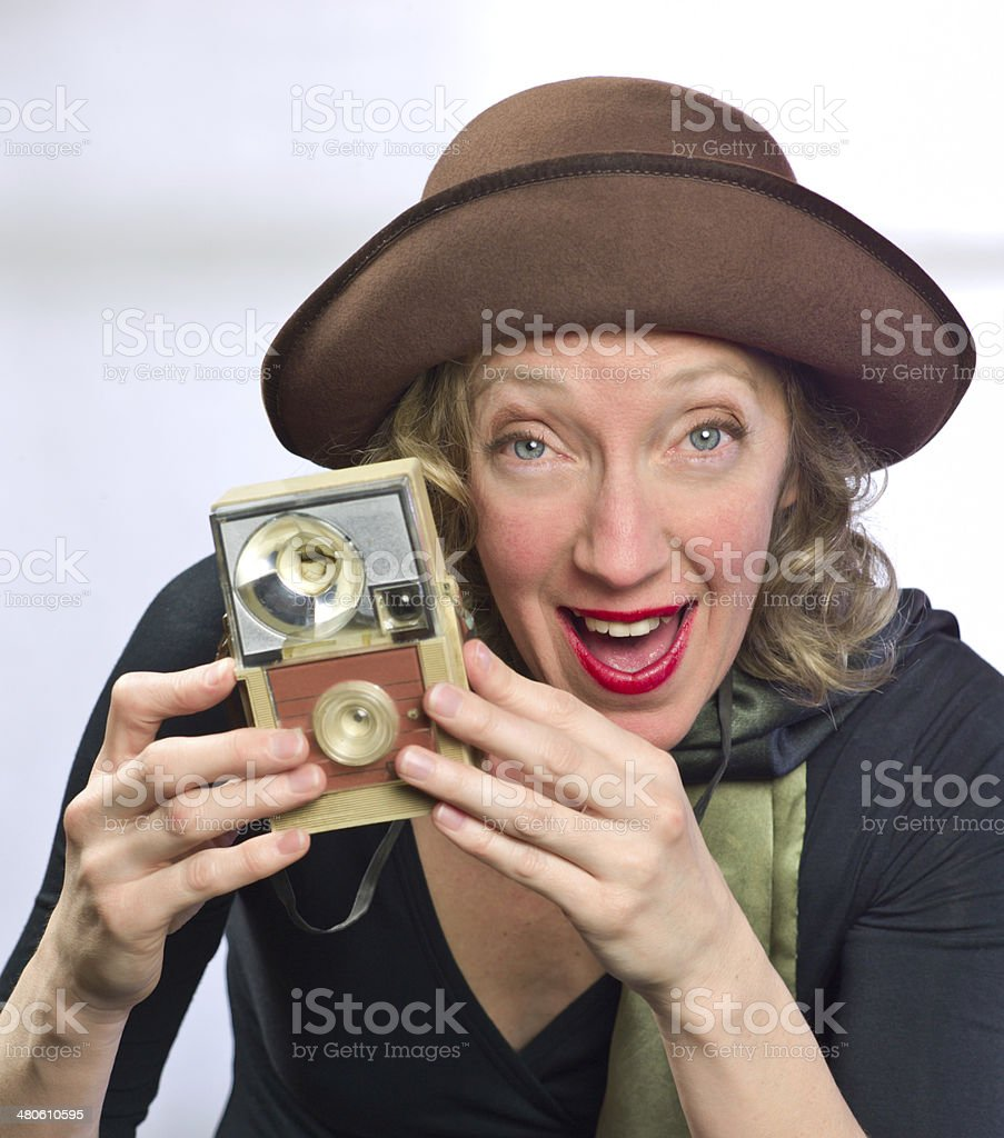 Woman with Vintage clothing and Camera. royalty-free stock photo