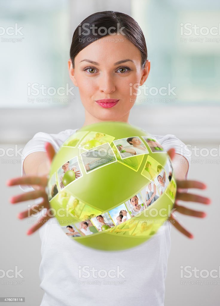 Woman with virtual pictures of her training program around her stock photo