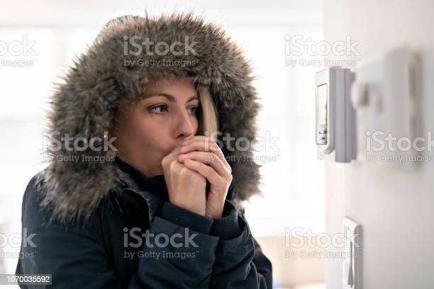 Photo of Woman With Warm Clothing Feeling The Cold Inside House