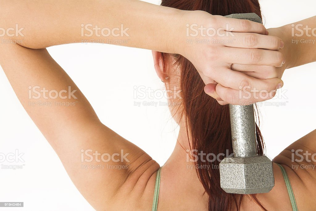 Woman with weights in the gym royalty-free stock photo