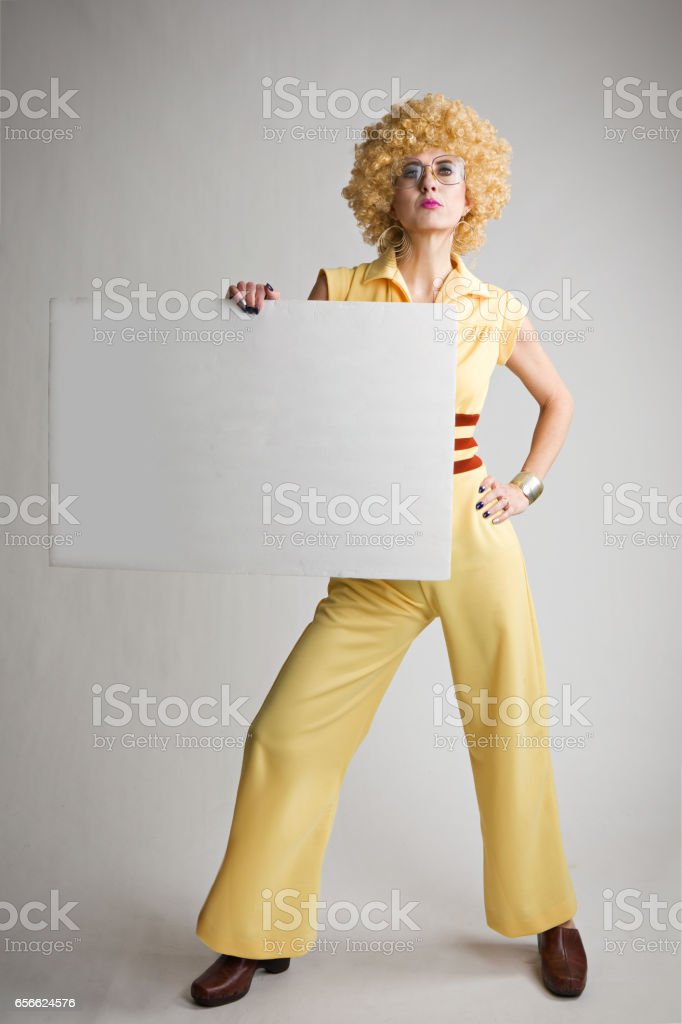 Woman WIth Weird 70's Look Holding Blank Sign stock photo