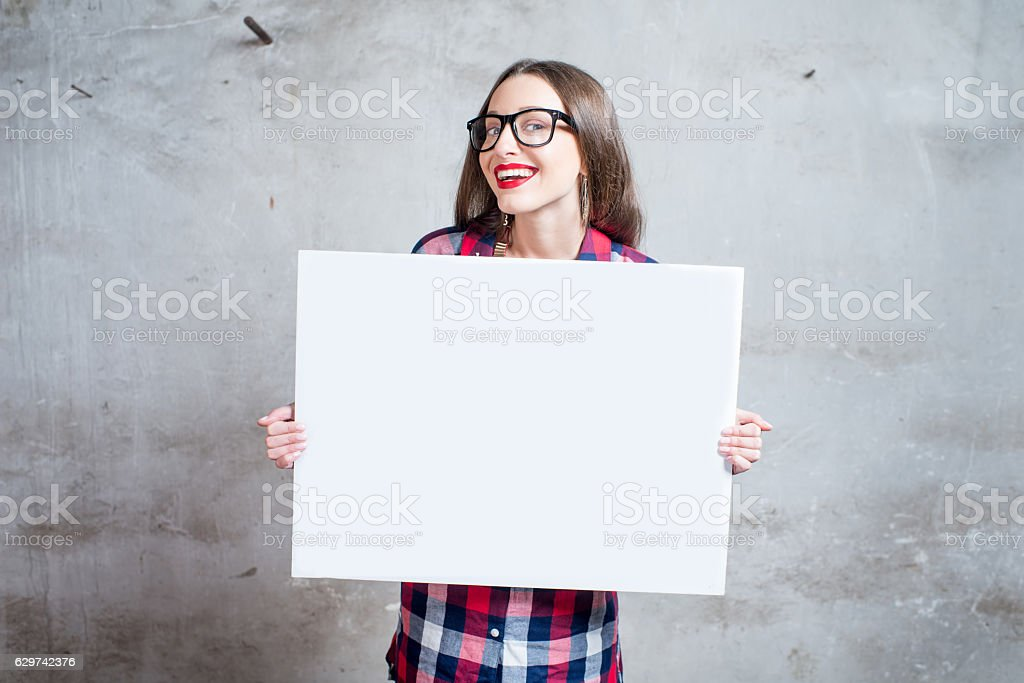 Woman with white board stock photo