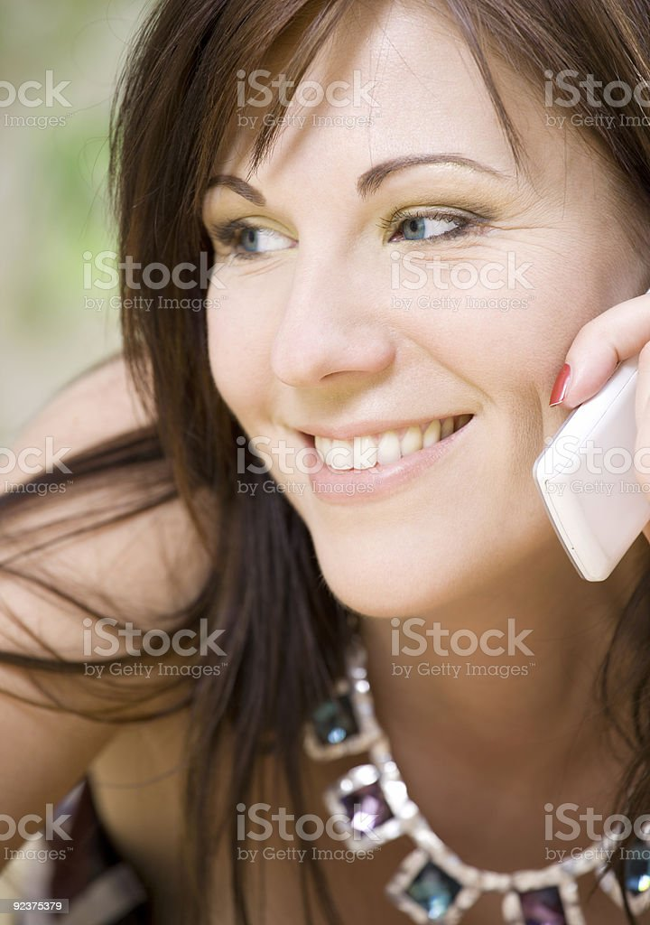 woman with white phone royalty-free stock photo
