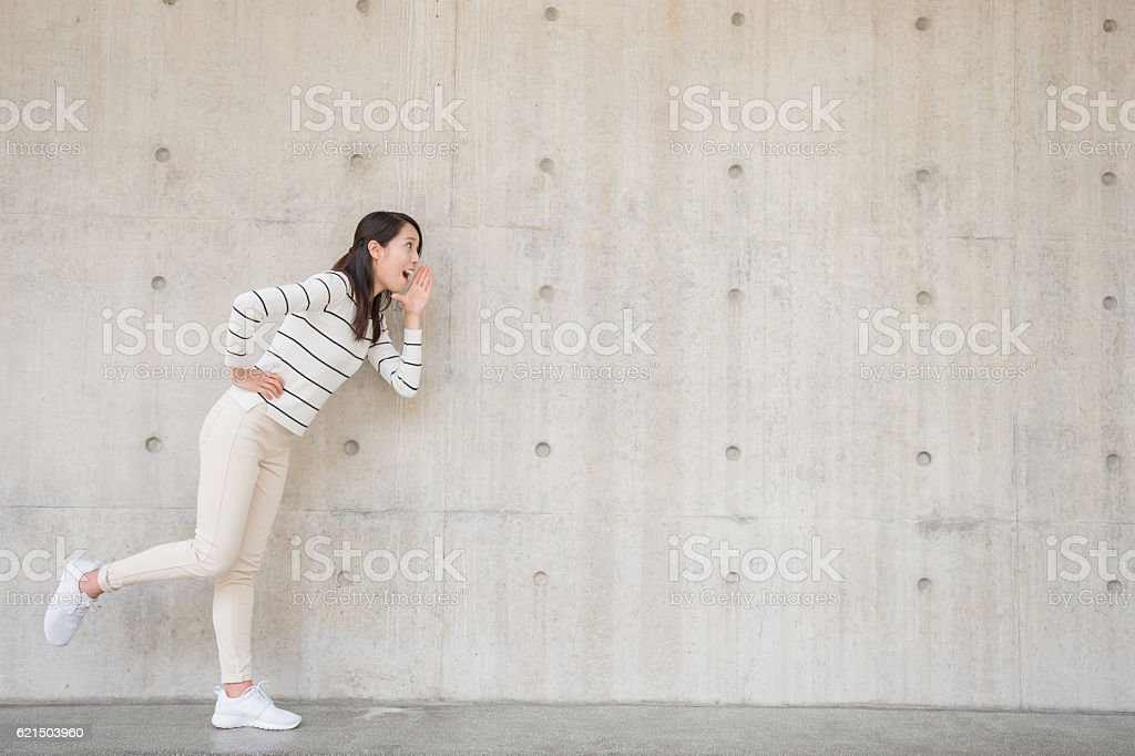 woman with white wall Lizenzfreies stock-foto
