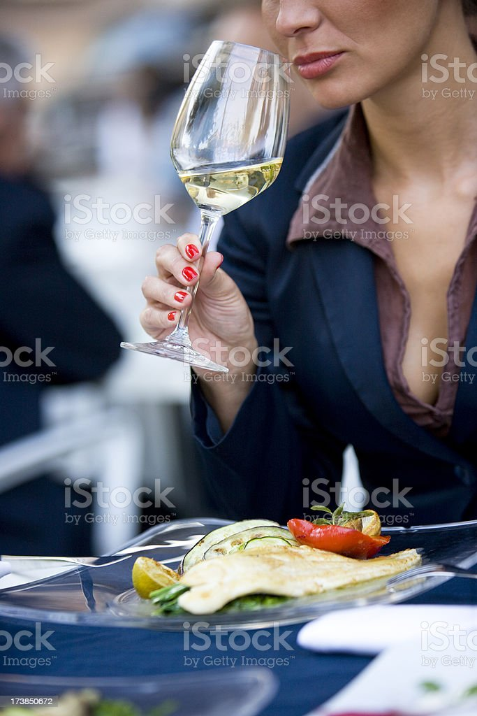 Woman with white wine stock photo