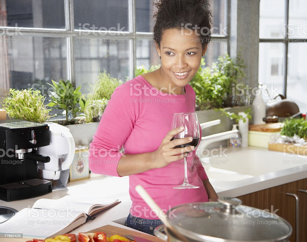 Woman with wine in kitchen royalty-free stock photo