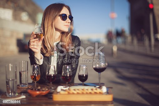 Woman with wine testing glasses