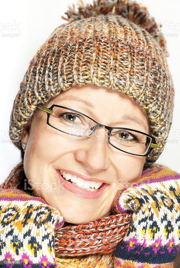 Woman with winter hat, gloves and  scarf royalty-free stock photo