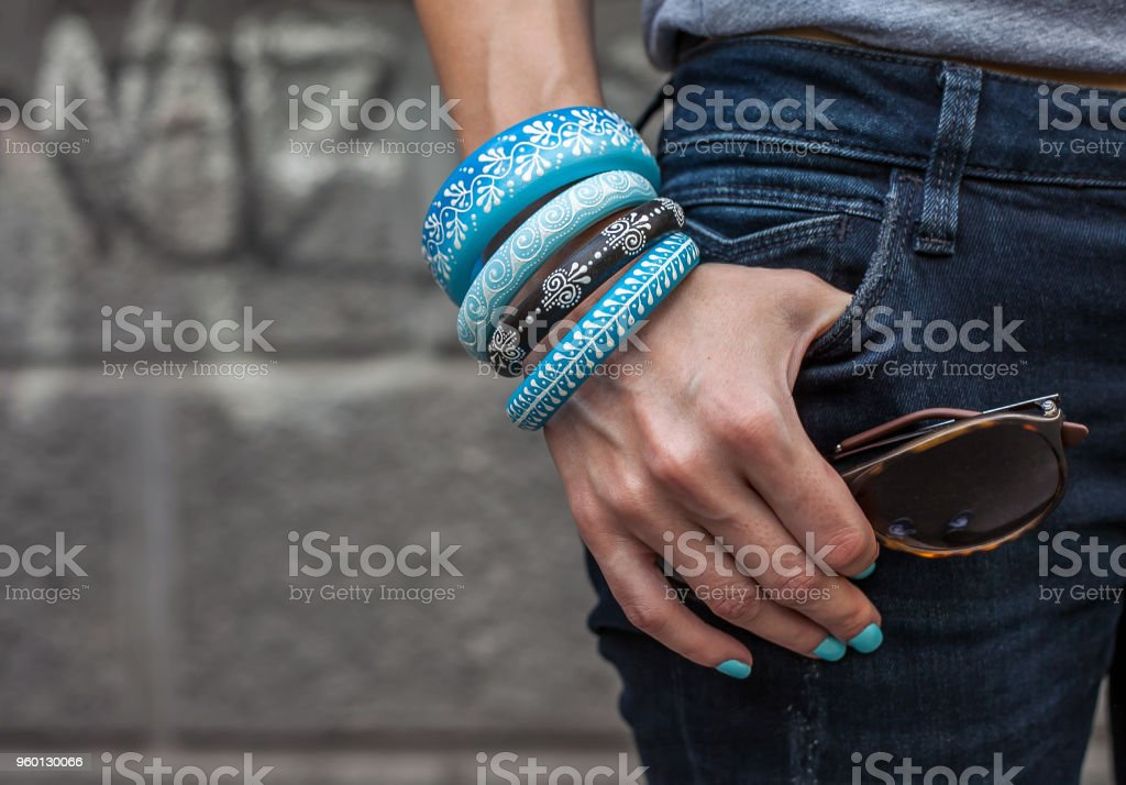 Woman with wooden boho style jewelry and sunglasses stock photo