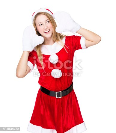 istock Woman with xmas party dress and listen something 524535733
