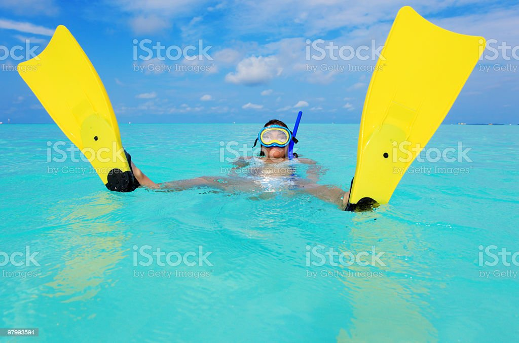 Woman with yellow flippers in blue ocean. royalty-free stock photo