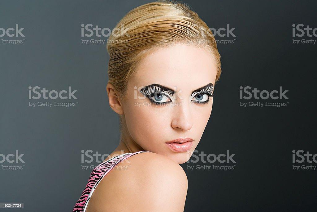 Woman with zebra stripe eye makeup stock photo
