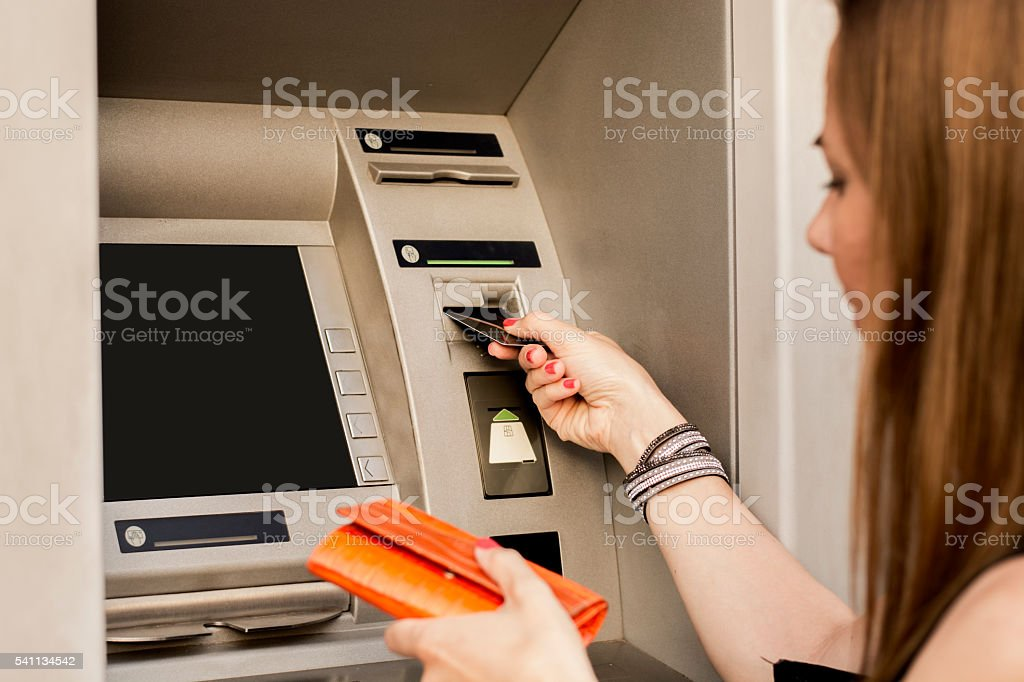 Woman Withdrawing from ATM stock photo