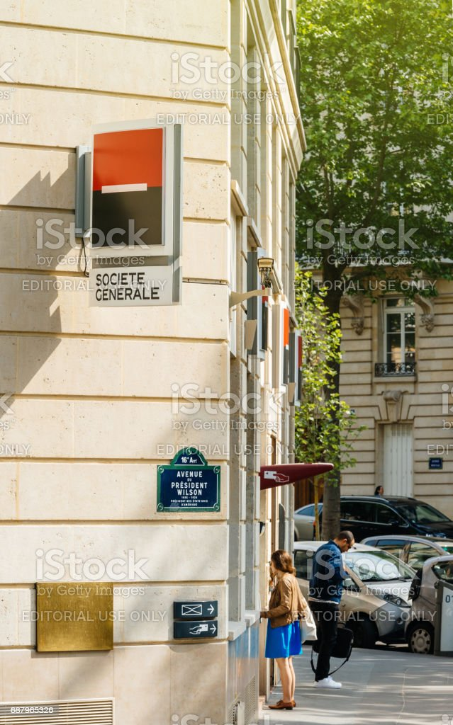 Woman withdrawing money at Societe Generale ATM automatic teller machine stock photo
