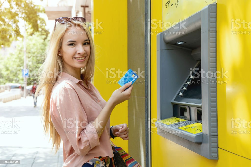 Woman withdrawing money at the ATM - Royalty-free 18-19 Years Stock Photo