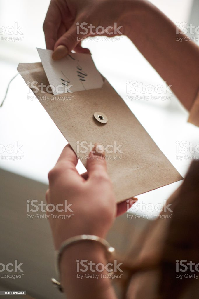 Woman Woman Holds Open Envelope With Inscription Will You Marry Me