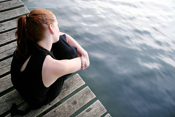 Woman wondering at lake stock photo