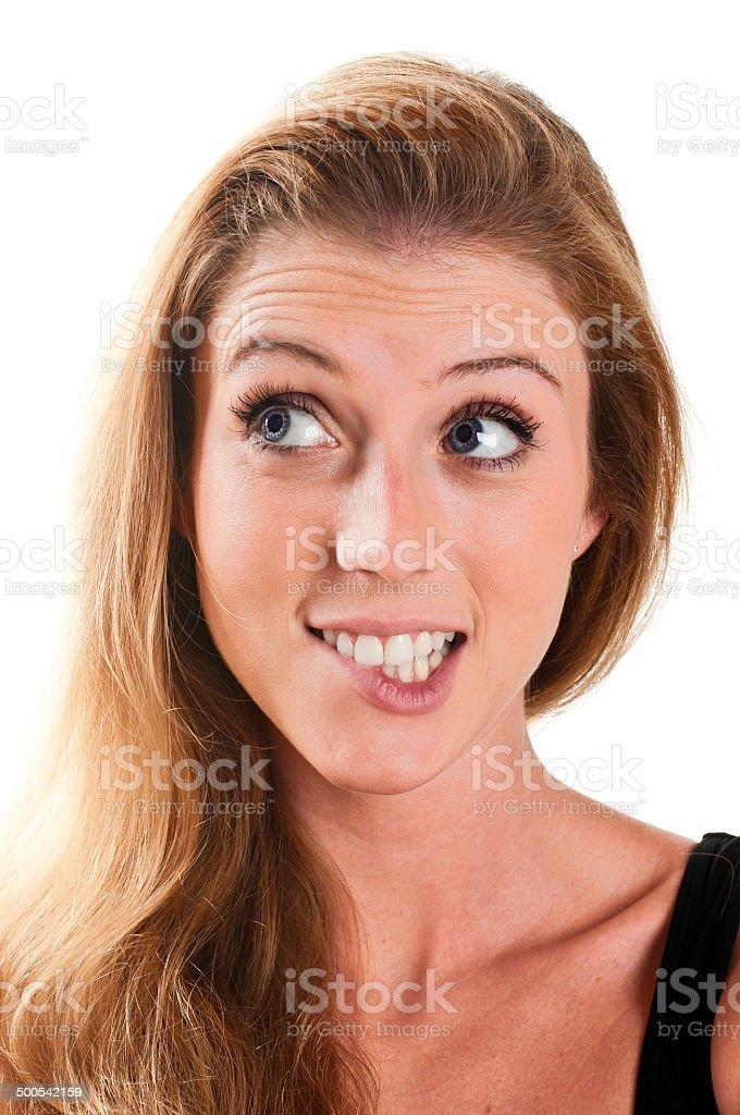 Woman wondering. Biting lips stock photo