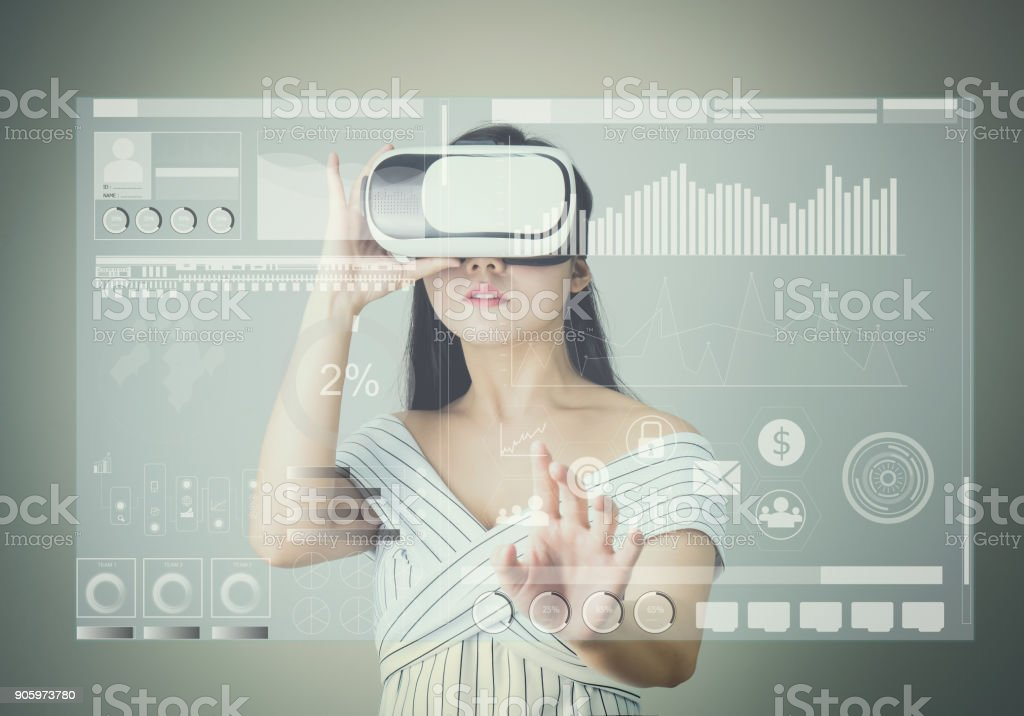 woman wore a virtual reality headset that simulates, And touch screen technology graph. the reality and looked up to see what the virtual reality was capable of rendering. stock photo