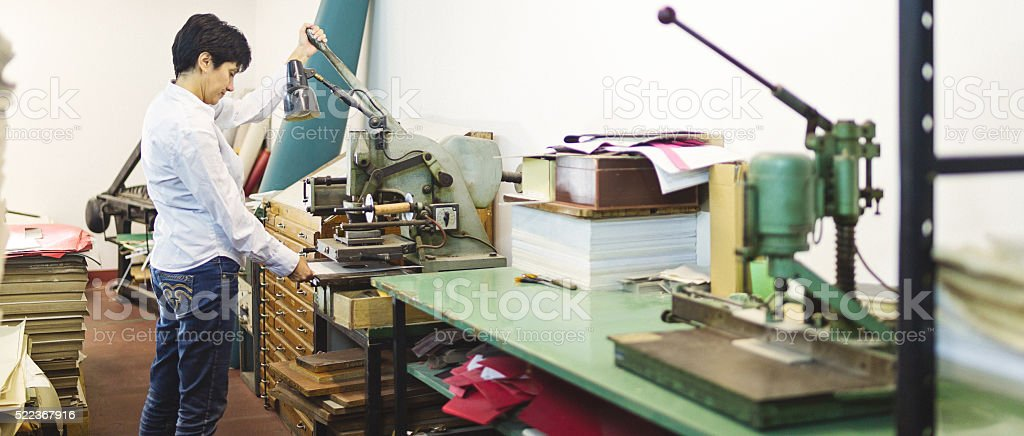 Woman work  hot stamping stock photo