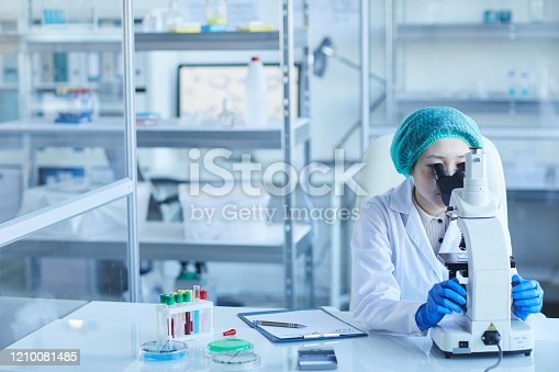 162264253 istock photo Woman Working Alone In Laboratory 1210081485