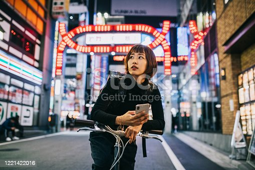 istock Woman Working as Bike Courier 1221422016