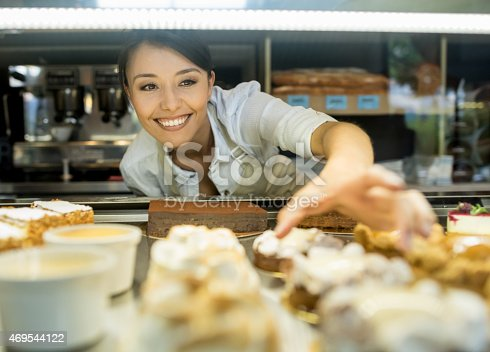 istock Woman working at a bakery 469544122