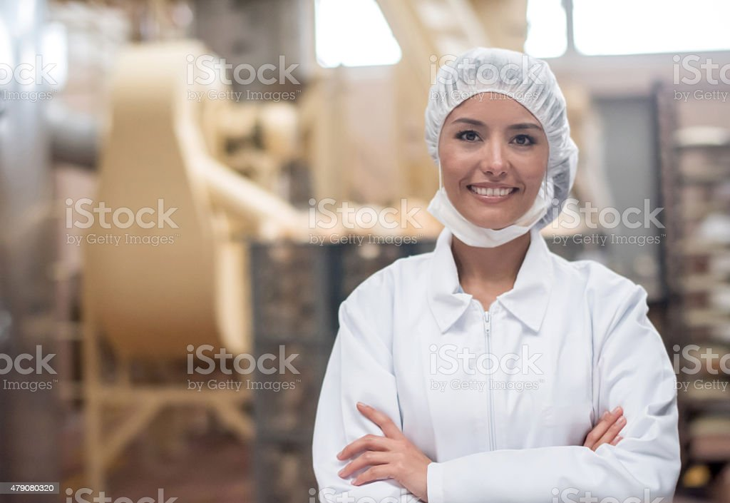 Woman working at a food factory stock photo