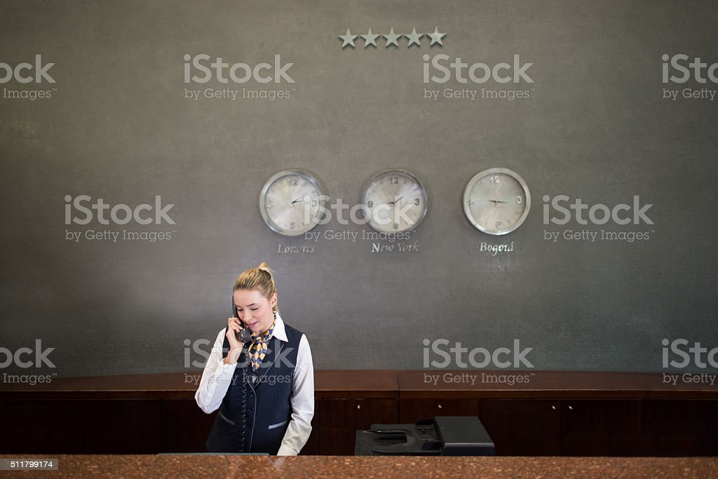 Woman working at a hotel stock photo