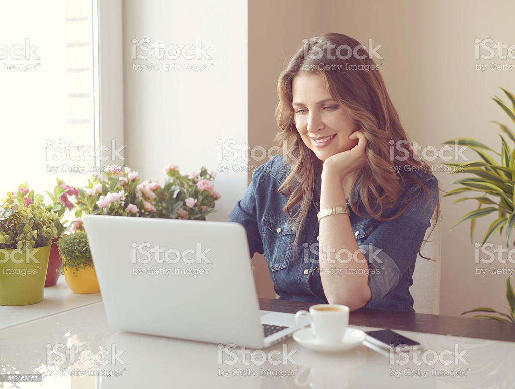 woman working at a laptop stock photo