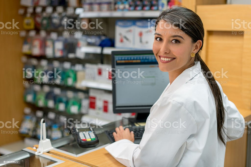 Woman working at a pharmacy stock photo