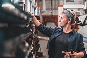istock Woman working at a repair shop 1134051660