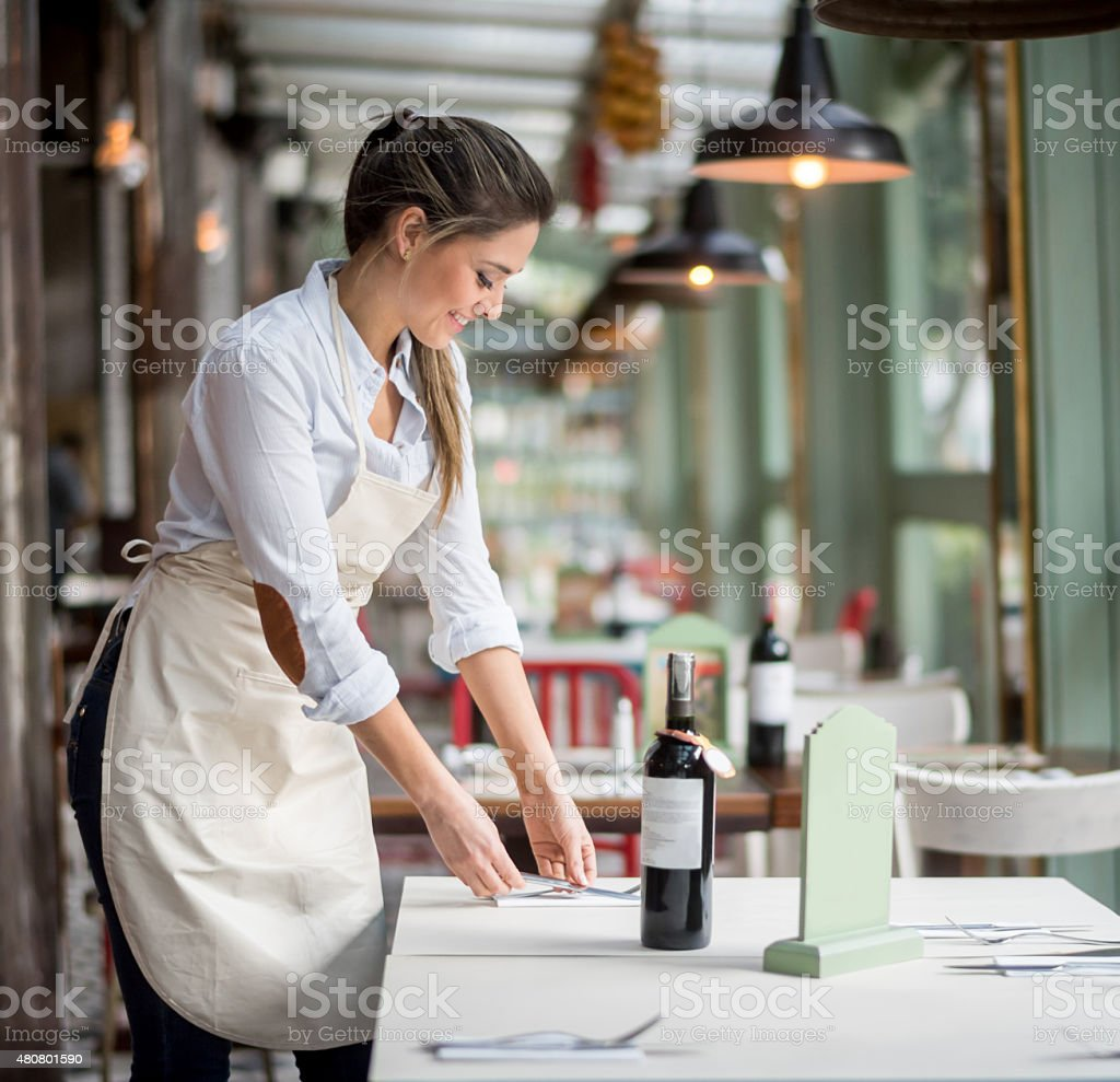 Woman working at a restaurant as a waitress stock photo