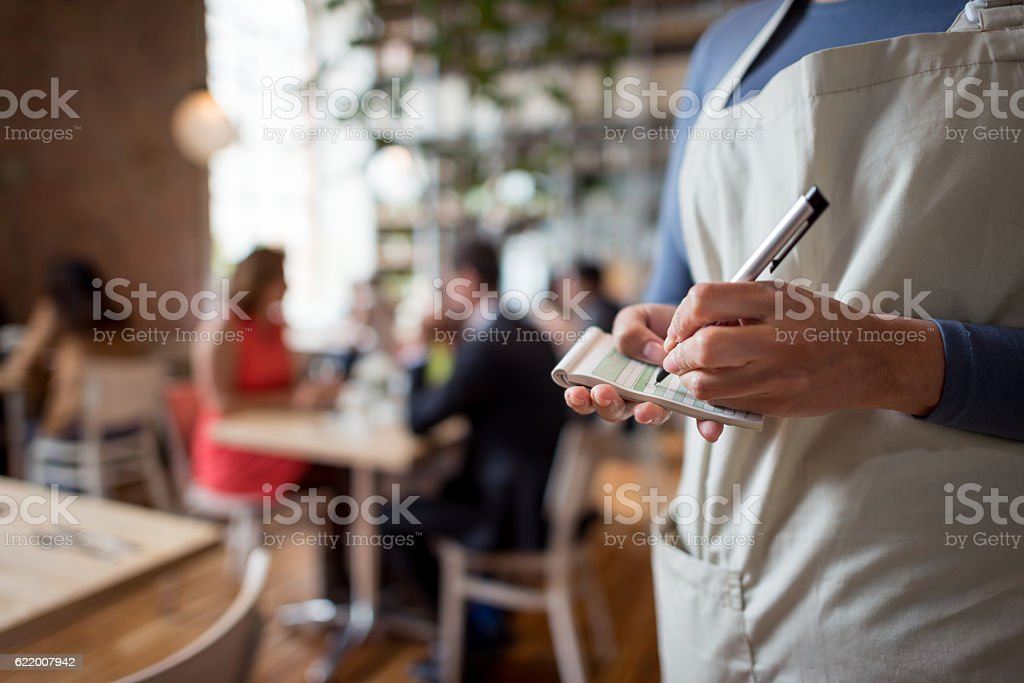 Woman working at a restaurant stock photo