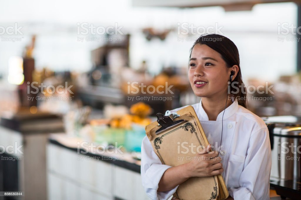 A woman working at a restaurant stock photo