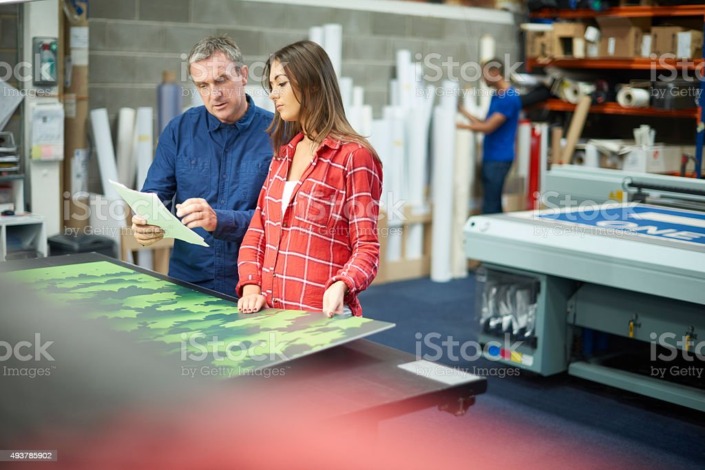 woman working at a signage company stock photo