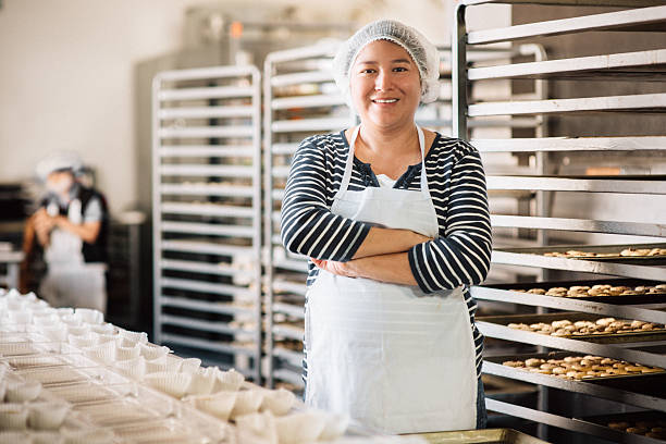 woman working at bakery workshop - mexikanisch kochen stock-fotos und bilder