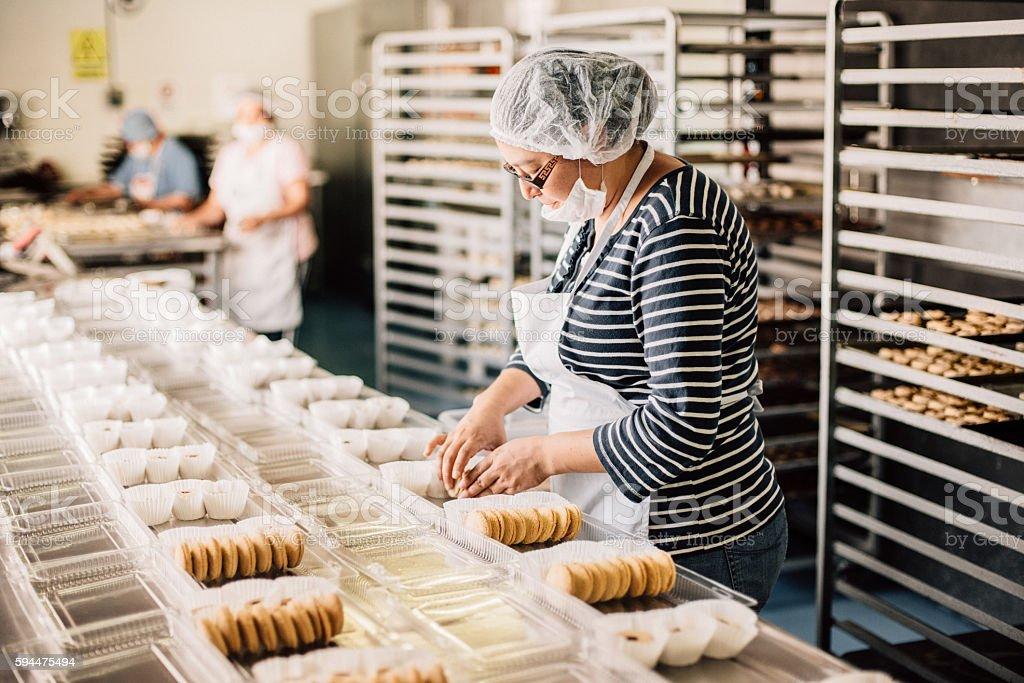 Woman working at Bakery Workshop - foto de acervo