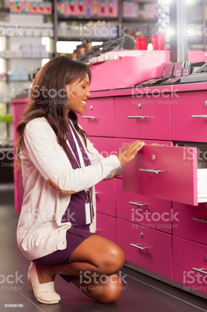Woman working at beauty store. stock photo