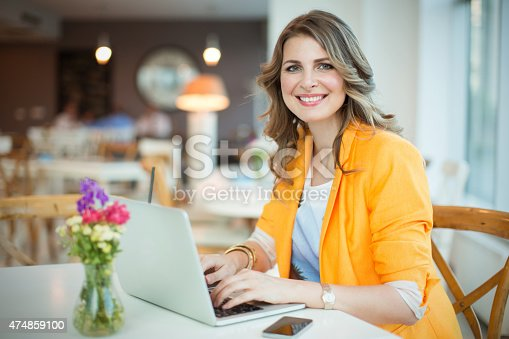 istock Woman working at cafe. 474859100