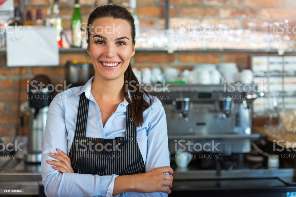 Woman working at cafe stock photo