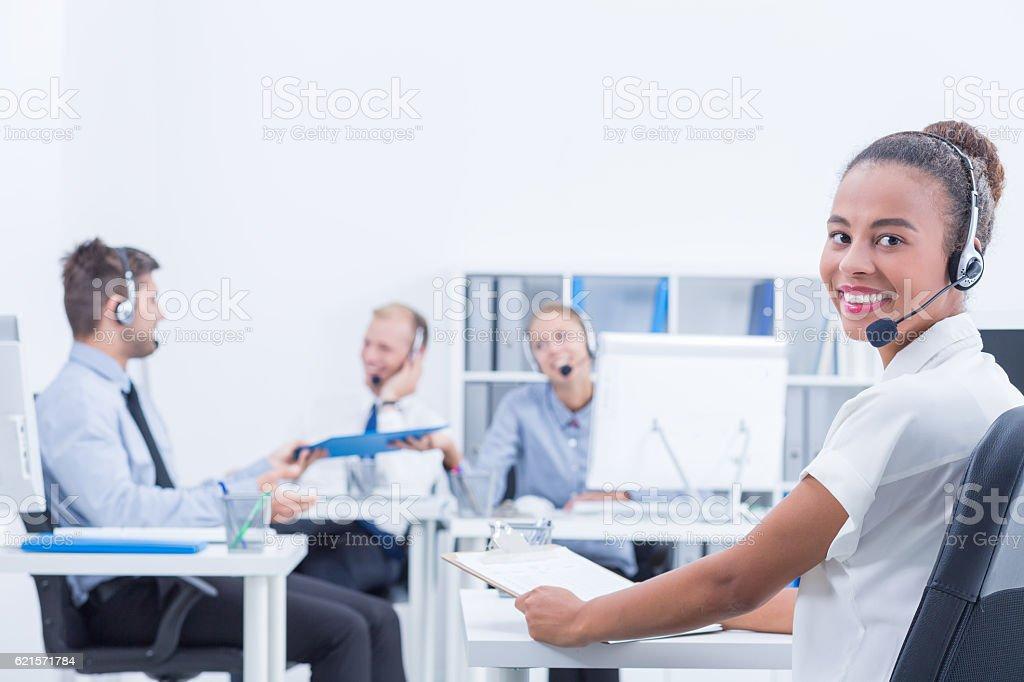 Woman working at call centre photo libre de droits