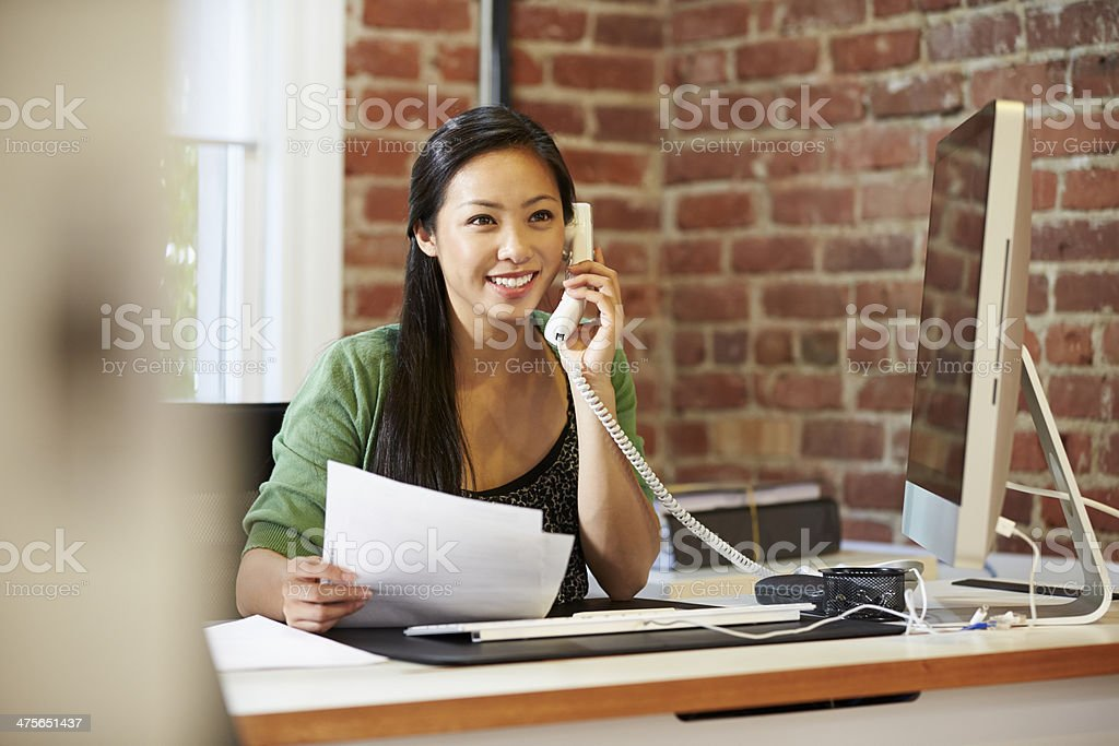 Woman Working At Computer In Contemporary Office stock photo