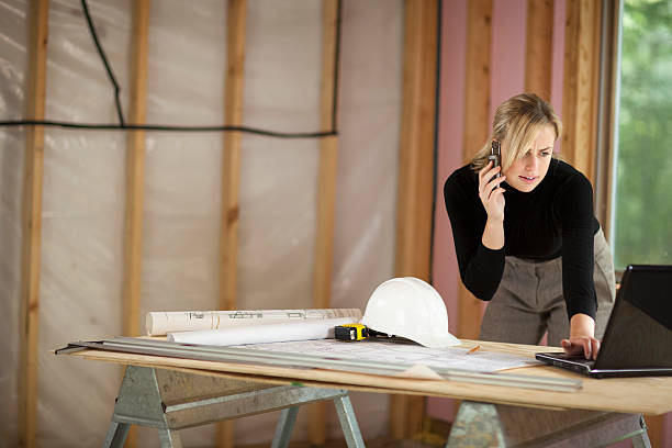 Woman Working at Construction Site stock photo