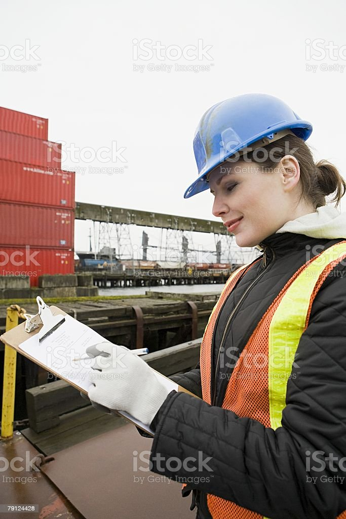 Woman working at container terminal royalty-free stock photo
