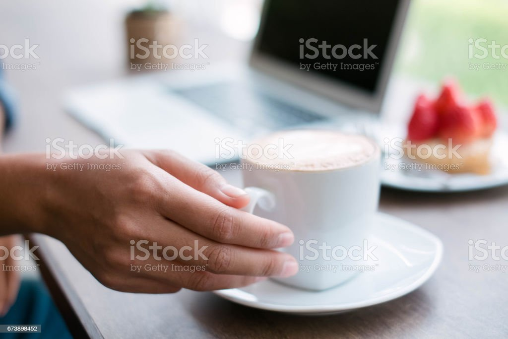 Woman working at home office hand holding coffee cup close up photo libre de droits