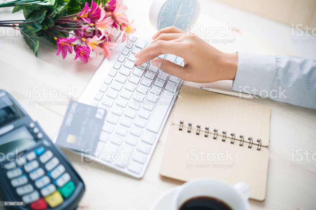 Woman working at home office hand on keyboard close up royalty-free stock photo